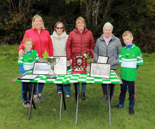 Hugo Casey's family at the Macroom U-12 Hugo Casey family. Included are Antoinette Casey, her daughters Angela and Fidelma, grandchildren Zoe and Danny, and Hugo's sister, Regina. On display are the trophies and photos of Hugo. Picture courtesy of Con Kelleher