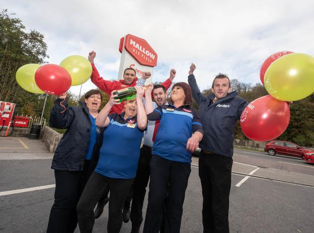 Staff members working at N20 Mallow Plaza toasting the good fortune of a lucky lotto punter who brought their winning quick pick ticket – worth a cool €1million – at the Costcutter store there last Wednesday