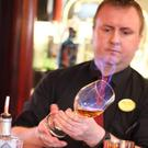 John Coleman putting the finishing touches to his award-winning 'Bee Right With You' cocktail