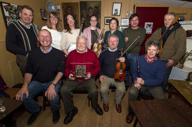 At the presentation of the Patrick O'Keeffe Traditional Music Festival Dedication to the Music of Sliabh Luachra Award trophy to Timmy O'Connor in Scully's Bar in Newmarket were, seated from left: Cormac O'Mahony, festival chairman; Timmy O'Connor, award recipient; Raymond O'Sullivan, Newmarket and Billy O'Keeffe, Rathmore. Back from left: Denis O'Callaghan, Rockchapel; Lisa and Siobhán Cronin, Newmarket; Leanora O'Callaghan, Rockchapel; Mary Cashman, Kilbrin; Eoin Stan O'Sullivan, Newmarket and Seán Angland, Ballydesmond. Photoby John Reidy