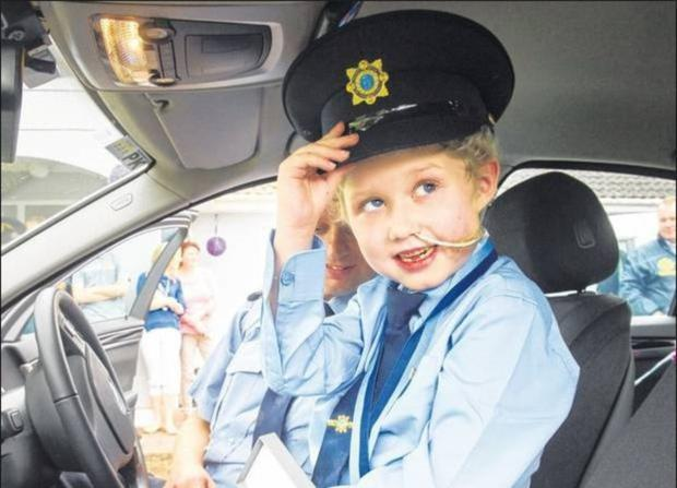 'Memories made that will last forever' - Fionn Doyle in his Garda uniform on his 7th birthday last August. Photo: Daragh McSweeney