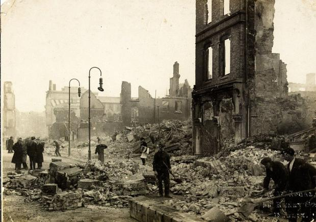 Workers clearing rubble on Patrick Street in the aftermath of the 'Burning of Cork'