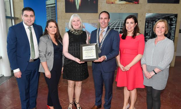 Former County Mayor Cllr Declan Hurley making a presentation to the Dromahane Community Park group of Cllr John Paul O'Shea, Lilian Meade, Mary Manning, Eileen Kelly and Ronnie Dunne at the 2018 County Mayor's Community Awards ceremony