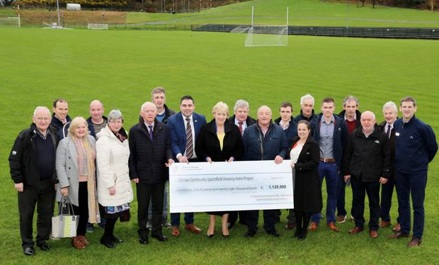 Minister Heather Humphreys presenting a cheque for €1.128 million to Banteer Community Sportsfield Group, with councillors Gerard Murphy and John Paul O'Shea FG, and Mary Wallace, Anne Maria Bourke and Louise Bourke of IRD Duhallow. Photo by Sheila Fitzgerald