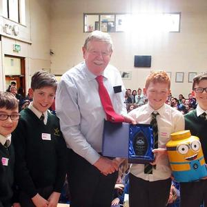 Martin Coughlan, one of the judges presents pupils from St Colman's Boys NS with their prize at McEgan College