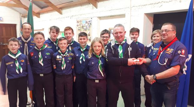 The scouts in Macroom received a visit from Terence McSweeney (far right) presented an award to to leader Joe Cunningham. Also pictured is Deirdre Henley (Scout leader) and Joe Willis (Scout leader)