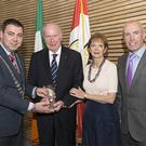 The former Mayor of County Cork, Cllr John Paul O'Shea, making a presentation to Bill Gainer during a civic reception held in his honour at County Hall in 2016. Also pictured were the late Mr Gainer's wife Gerry and Cork County Council chief executive Tim Lucey. Photo by Martin Walsh