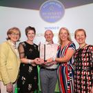 Claire O'Leary, William O'Leary and Eileen Daly of Munster Fire and Safety receiving an All-Ireland Business Award at Croke Park from Mairead McGuinness MEP, Vice-President of the European Parliament and Dr Briga Hynes of the Kemmy Business School at the University of Limerick and cochair of the judging panel. Photo: Conor McCabe