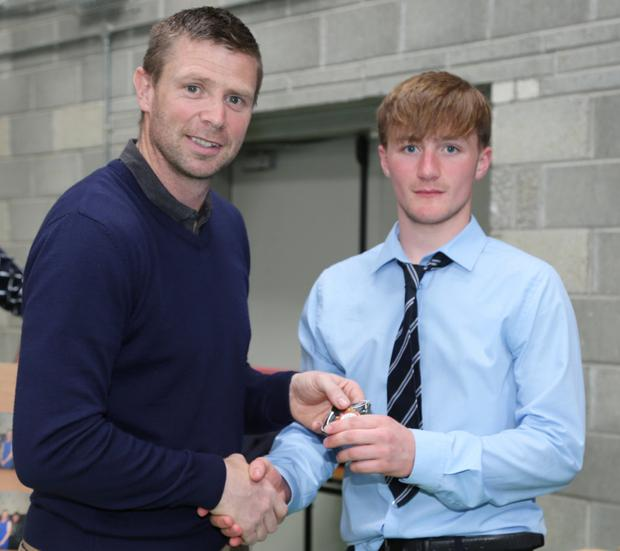 Niall O' Riordan receiving his Medal from Tomás O' Sé at the Medals Presentations Event at the Patrician Academy, Mallow