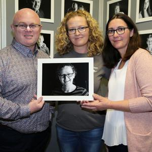 Local photographers Eddie Hennessy and Eileen O'Connor with Éilish Hourigan who is one of the subjects of their Faces of Newmarket Project, pictured at the Áit and Faces of Newmarket Exhibition at Newmarket Motors. Photo by Sheila Fitzgerald