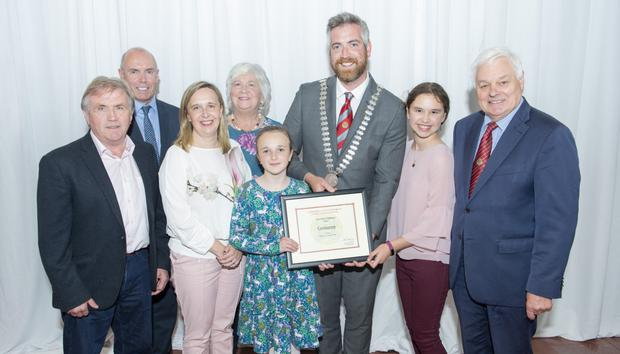 Cork County Council chief executive Tim Lucey (back left), Cork County Mayor Cllr Christopher O'Sullivan and Cllr Frank O'Flynn (front right) with representatives from Coolagown, which won the 'Best Village' category in the 2018 Cork County Litter Challenge. Photos by Gerard McCarthy
