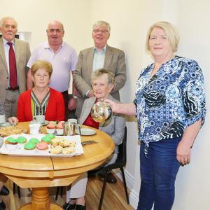Volunteer Eileen O' Connor pouring a cuppa for Sister Consilio, Sister Agnes, Phil McGuinness, Mary Heffernan, Marie Harding, Michael O'Sullivan, Brendan O'Reilly, and Joe Heffernan in one of the upstairs meeting rooms at the newly opened Friends of Cuan Mhuire Centre in Newmarket