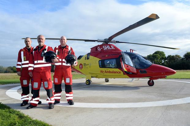 Captain John Murray (centre) with crew members Paul Traynor and Brian O'Callaghan pictured with Irish Community Rapid Response (ICRR) charity air ambulance at Rathcoole Aerodrome
