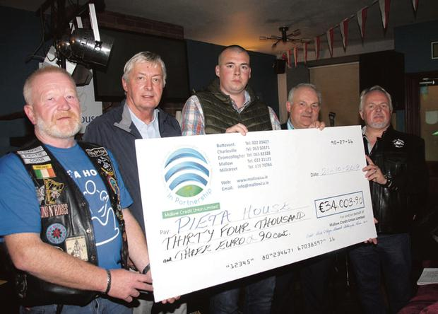 Bertie O'Regan, Mick O'Regan's nephew Kevin Buckley, Connie Ryan and Michael Palmer presenting the proceeds from the 2019 Mick O'Regan Memorial Bike Run to Pat Duffy of Pieta Hosue (second left) during an event at Kit Roche's Bar in Buttevant