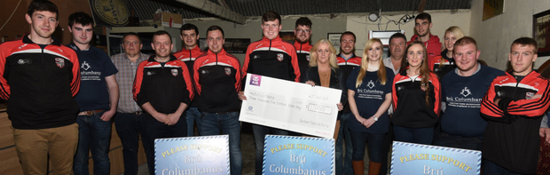 Kelvin O'Connor, chairman, Banteer Macra presenting a cheque for €3,500, proceeds from the club's Field Evening staged in Kilcorney, to Anne Maria O'Connor representing Bru Columbanus. Photo: John Tarrant