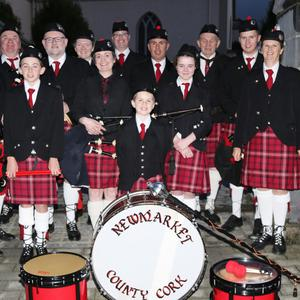 Newmarket Pipe Band played a selection of tunes at the site of the former RIC Barracks on Main Street