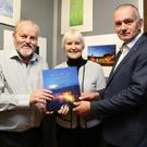 Poet John Tado and Photographer Neily Curtin with Alice Taylor who launched the book