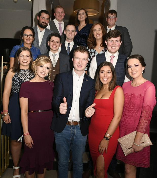 Martin O'Regan from Banteer Macra, the All-Ireland -23 stock judging winner congratulated by club members at the Macra National Conference in Cork. Picture: John Tarrant