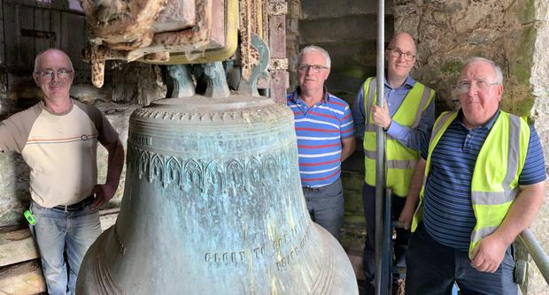 Craftsmen Paul and Pat Coughlan, conservation engineer John Kelly and Sean Hyland of Samco Engineering about to set about restoring the St George's bell