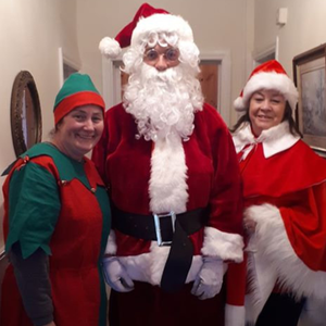 Santa on his visit to Newmarket with his helpers elf Soty Guerin and Mrs Clause aka Marion Murphy