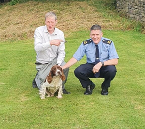 Garda Shane Hayes with 'Jake' and his owner Gerard McMahon
