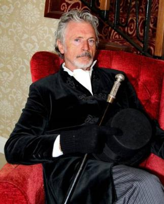 Hollywood actor Patrick Bergin in his role as the evil Dr Philip Cross in the Lee Valley Players 2016 production of 'Murder at Shandy Hall - The Musical'