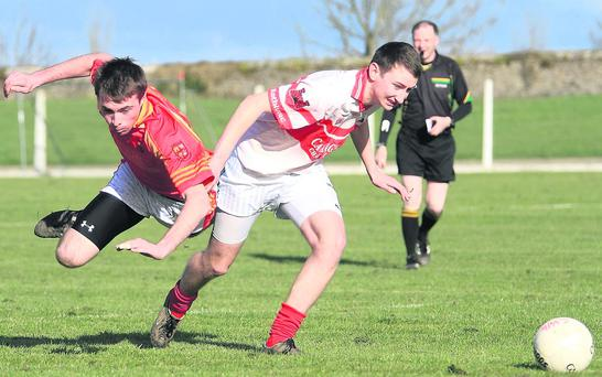Mallow's Donal O'Siochain is sent flying under the challenge of Charleville's Jason Hara as they contest a loose ball during the North Cork U21A semi-final. Photo: Eric Barry