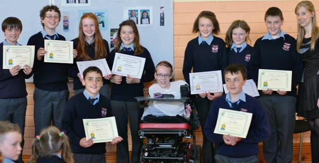 Joanne O'Riordan who was the special guest at the 6th class graduation at St Lachteen's NS. with pupils and 6th class teacher Ms. Aislinn Sexton.