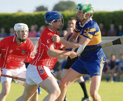Kilworth's Damien McNamara ensures there's no way forward for Carrigaline's Kevin Kavanagh during last Sunday evening's Premier Intermediate Championship game in Watergrasshill. Photo: Eric Barry