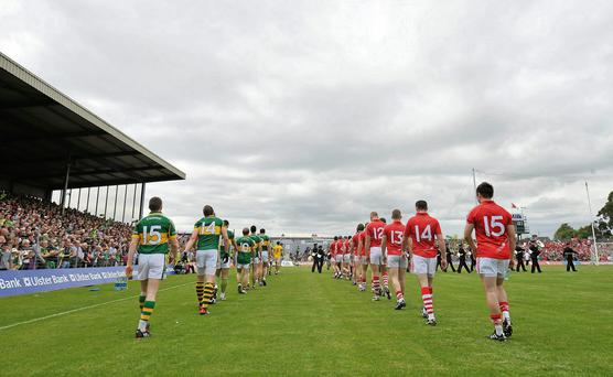 The Kerry and Cork teams walk in the pre-match parade.