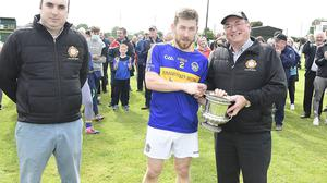 Cullen captain Mike O'Riordan receives the Ducon Cup from Dan Dennehy, Duhallow CCC in the presence of Steven Lynch, Chairman Duhallow Junior Board Photo by John Tarrant