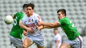 Colm O'Callaghan of Cork is tackled by James Dolan, left, and Darren Giles of Westmeath during the Allianz Football League Division 2 Relegation play-off match between Cork and Westmeath at Páirc Uí Chaoimh. Photo by Eóin Noonan / Sportsfile
