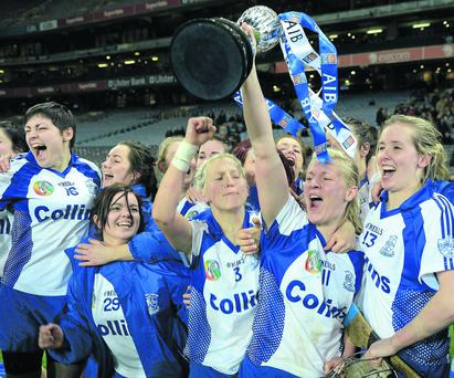Deirdre O'Reilly and her Milford teammates celebrate with the cup. Photo: Ray McManus / SPORTSFILE