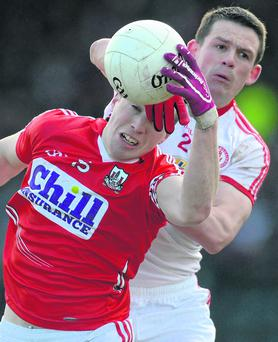 Colm O'Neill, Cork, in action against Aidan McCrory, Tyrone. Photo: Brian Lawless / SPORTSFILE