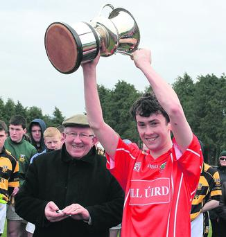 Jubilant Kilworth captain, Will Condon, raises the North Cork U21 B football trophy after his side won a thrilling final in Castletownroche last weekend. Photo: Eric Barry