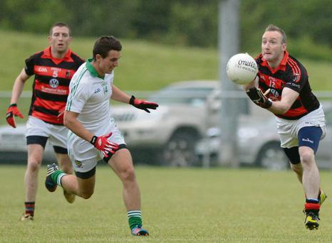 Tony O'Keeffe seeks out a Newmarket colleague against Aghada in the Co. SFC at Mourneabbey. Picture John Tarrant