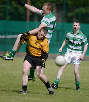 Lismire ''keeper Paddy Sheahan endures a challenge from a Ballinacurra attacker in the Co. JBFC at Ballyhooly. Picture John Tarrant