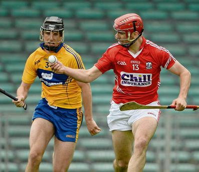 23 June 2013; Colm Casey, Cork, in action against Darragh Corry, left, and Kilian Ryan, Clare. Munster GAA Hurling Intermediate Championship, Semi-Final, Cork v Clare, Gaelic Grounds, Limerick. Picture credit: Brendan Moran / SPORTSFILE