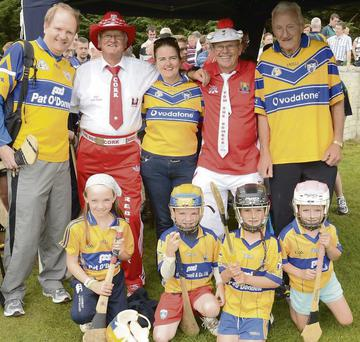 Clare supporters Terry Walsh, Eva MacGrath, Michael MacGrath, Kathy & Michael Dinan and Oisin and Aoife MacGrath with Pa the Piper Hurley and Tom The Bomber Roche at the worlds biggest hurling game in Meelin. Photo; Eileen O'Connor