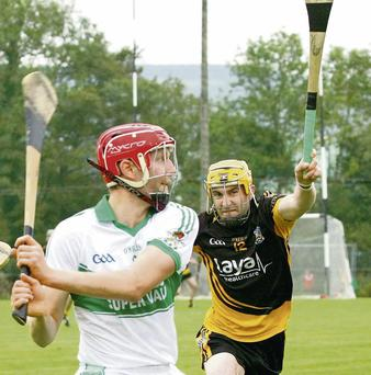 Lorcan McLoughlin (Kanturk) shoots goalwards with Liam Coleman (Fermoy) attempting the block down.