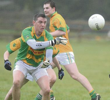 Boherbue's Kevin Murphy lays off the ball agaimst Millstreet in the Ducon Cup. Picture John Tarrant.