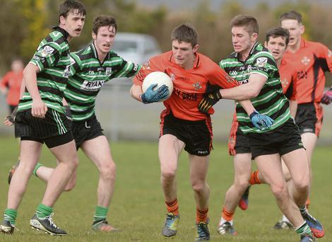 Michael Cotrell, Duhallow, breaks through the Douglas rearguard on the Credit Union U-21 Football Invitation Cup Final in K