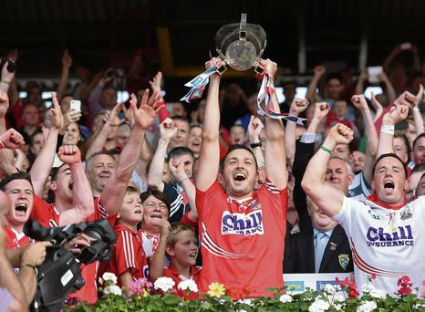 13 July 2014; Cork captain Patrick Cronin celebrates with his team-mates as he lifts the cup after the game. Munster GAA Hurling Senior Championship Final, Cork v Limerick, Pairc Uí Chaoimh, Cork. Picture credit: Brendan Moran / SPORTSFILE