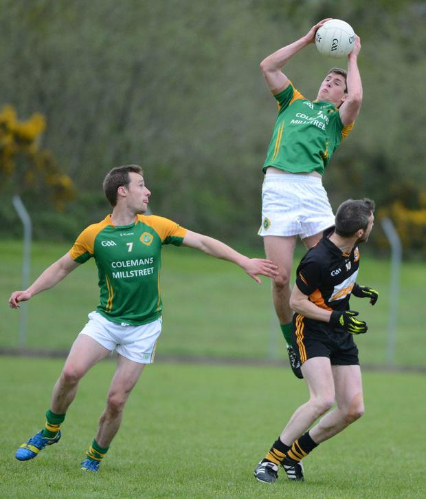 Kevin Crowley wins possession for Millstreet against Glenville