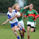Chris O'Leary (Knocknagree) bursts out of defence against Fr. ONeills in the Co. JAFC quarter final in Mallow