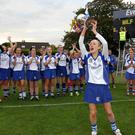 Sarah Sexton, Milford Captain, lifts the Cup after the win over St. Catherines. Picture: Jim Coughlan