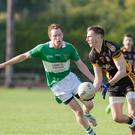 Fermoy's Brian O'Sullivan lays of a handpass before Glanworth's Michael Sheehan can get close to him during the semi-final clash between the sides last weekend in the County Intermediate Football Championship. Photo: Eric Barry/Blink Of An Eye