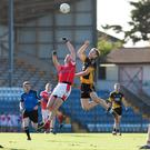 Fermoy's Darragh O'Carroll out jumps Mayfield's Stephen Hackett to get his fist to a kick-out during last Saturday's Intermediate Football County Final