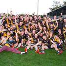 Fermoy players and selectors celebrate after being crowned Intermediate Football County Champions after victory over Mayfield in last weekend's final replay. Photo: Eric Barry/Blink Of An Eye