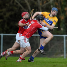 David Fitzgerald, Clare, in action against Colm Spillane, 4, and Stephen Moylan, Cork. Photo by Ray McManus/Sportsfile